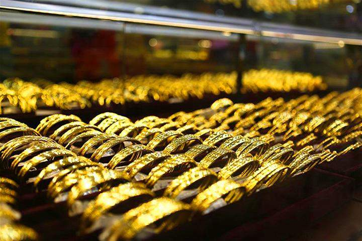 Gold bracelets are displayed at a gold jewellery in Yangon on 14 July 2016.