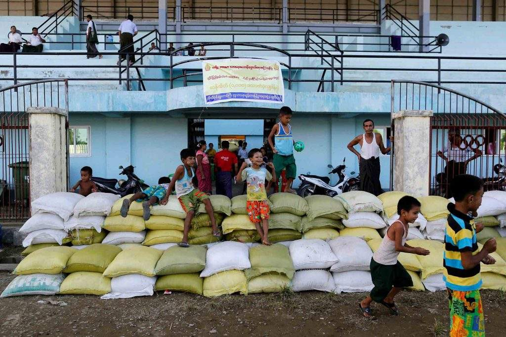 Rakhine Buddhists who have fled from violence in Maungtaw are passing their time in a temporary shelter at a stadium in Sittwe, Myanmar on October 25, 2016. Photo: Reuters/Soe Zeya Tun