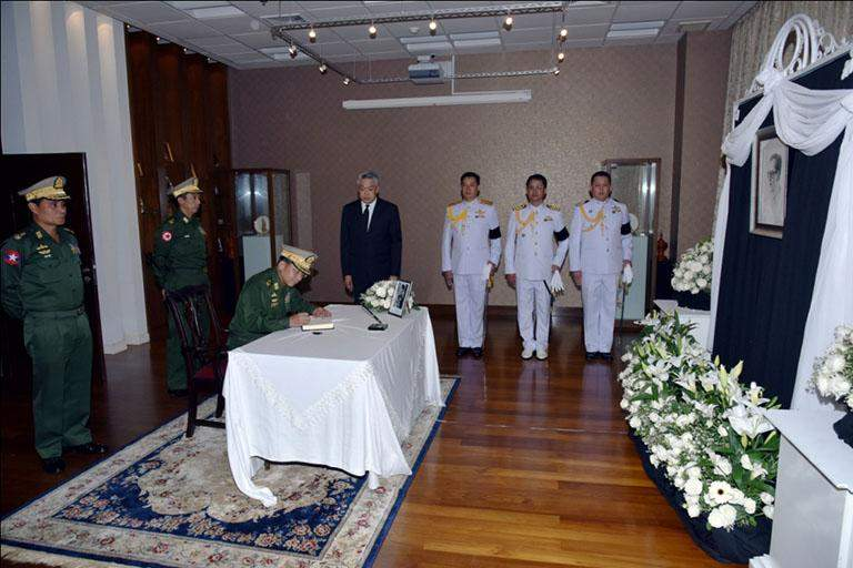 Senior General Min Aung Hlaing signing the book of condolence for Thai King Bhumibol Adulyadej at the Embassy of Thailand. Photo: MNA