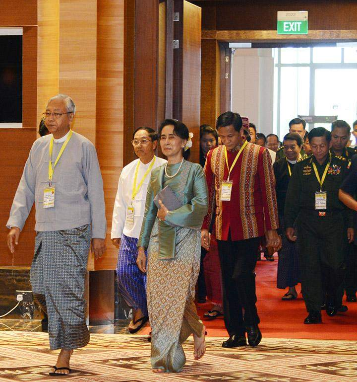 President U Htin Kyaw and State Counsellor Daw Aung San Suu Kyi , two vice presidents and Senior General Min Aung Hlaing arrive to attend the ceremony to celebrate first anniversary of signing the Nationwide Ceasefire Agreement.