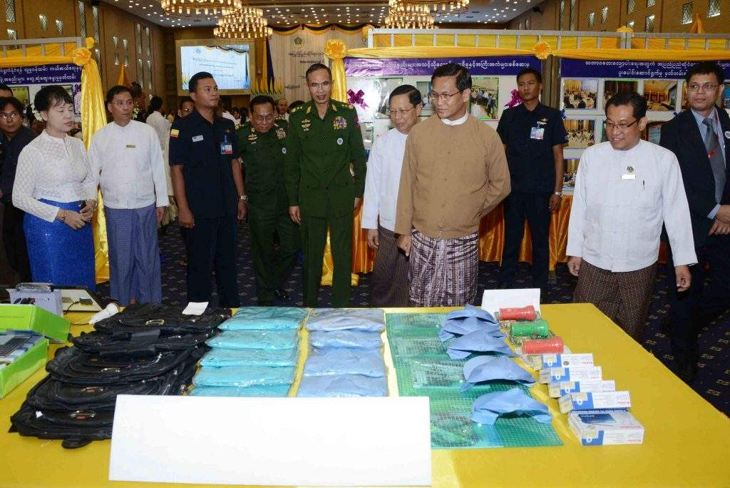 Vice President U Henry Van Thio inspecting a booth. Photo: MNA