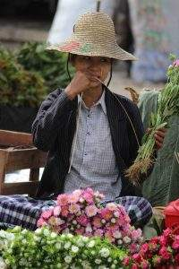 A vendor preparing the flowers to sell. Photo : Aye Min Soe