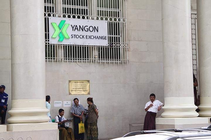 People seen outside the Yangon Stock Exchange in Yangon.