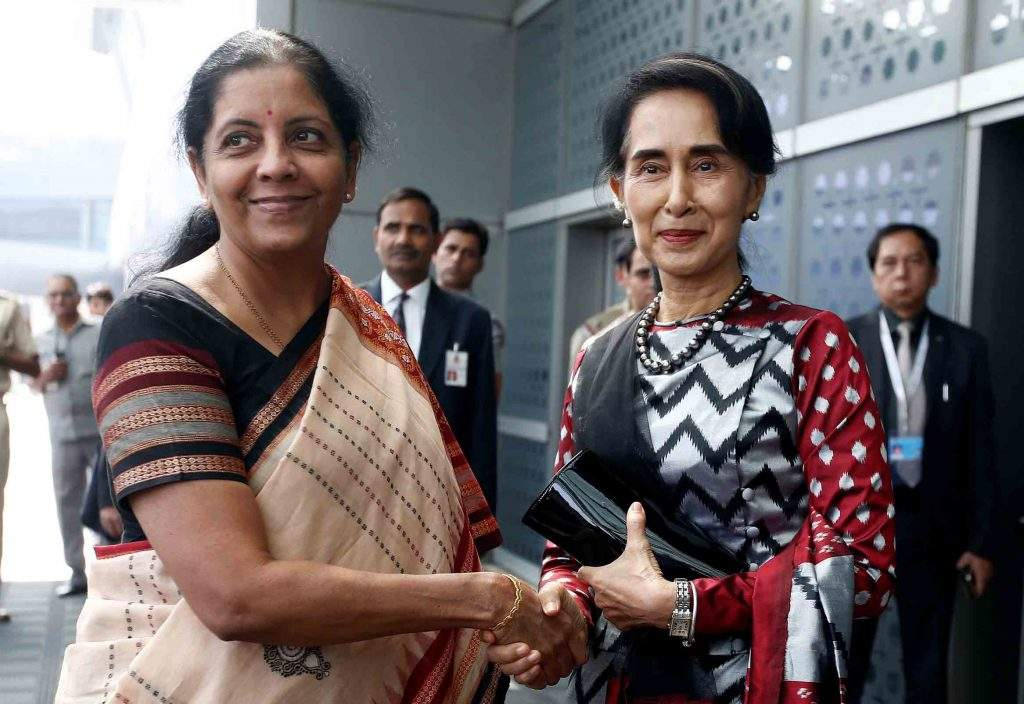 State Counsellor Daw Aung San Suu Kyi shakes hands with India's Minister of State for Commerce and Industry Nirmala Sitharaman, upon her arrival at the airport in New Delhi, India, on 17 October. Photo: Reuters
