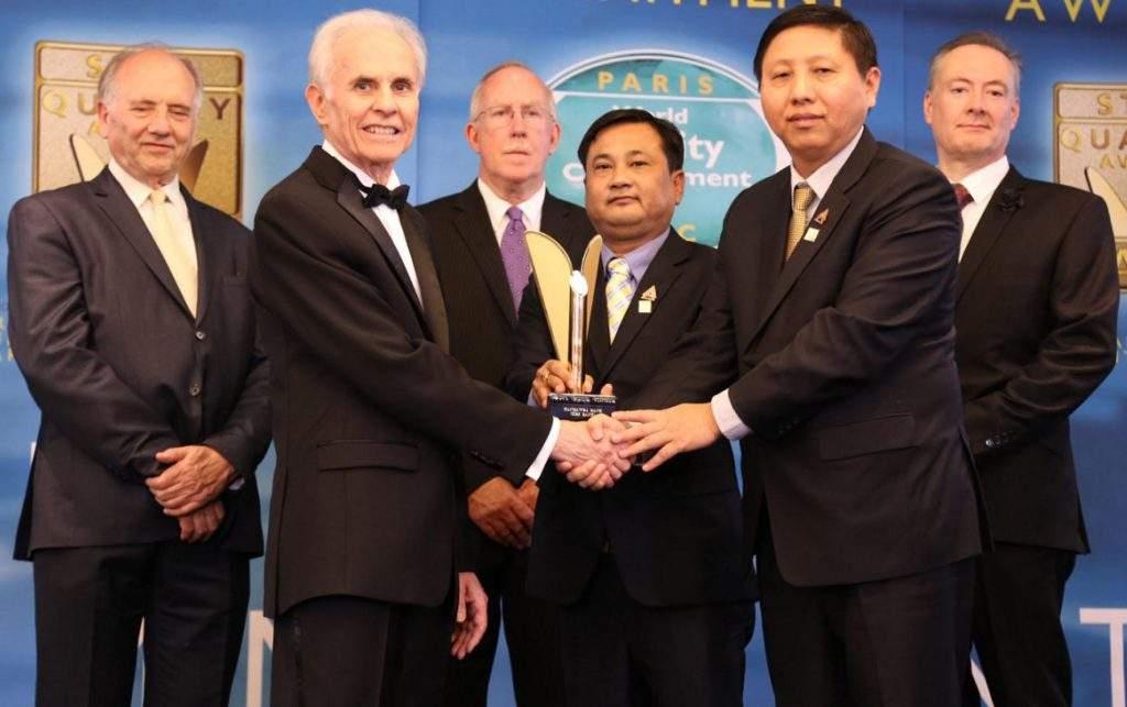 U Tun Lin and U Htay Aung Kyaw of KBZ Group of Companies accept World Quality Commitment Award in Paris. Photo: KBZ