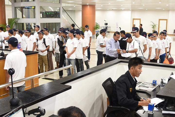 Those arriving from Malaysia queuing at immigration counter at Yangon International Airport.