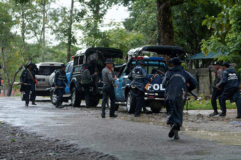 Police forces prepare to patrol in Maungdaw township at Rakhine State, northeast Myanmar, on 12 October