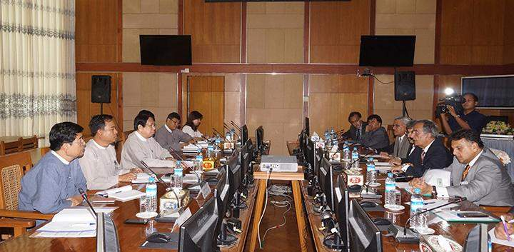 Union Minister for Information Dr Pe Myint receiving a delegation from the Pakistan National Management College.