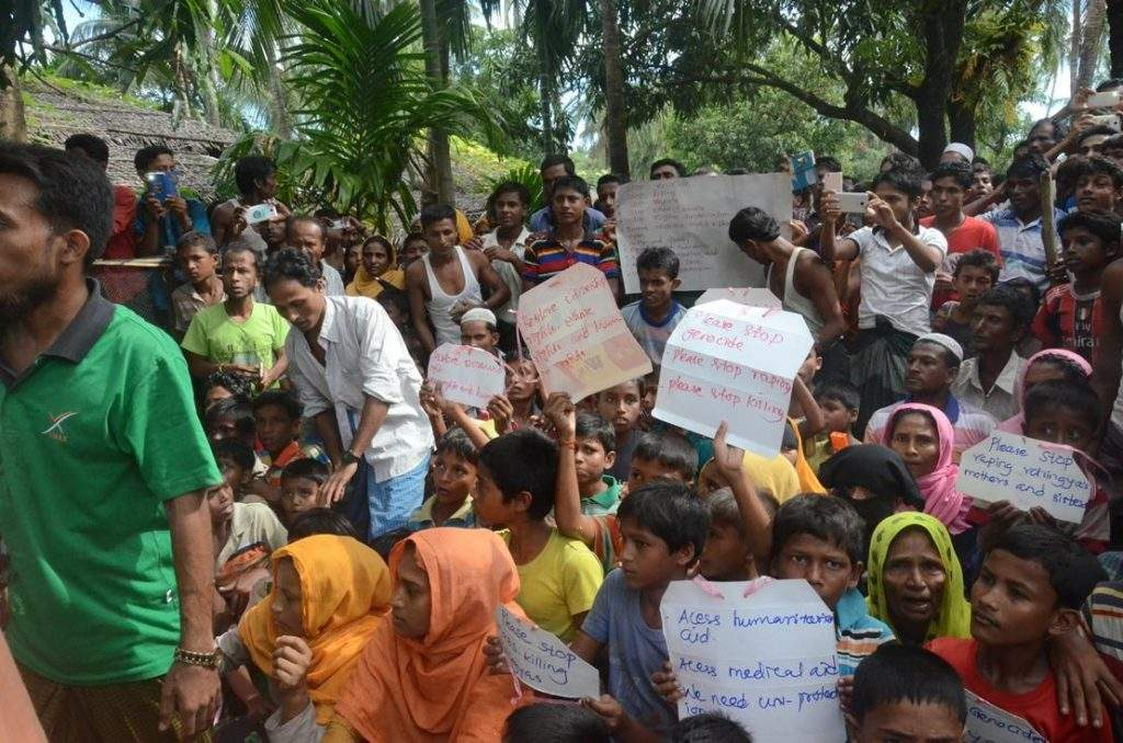 Placards held by Muslim villagers, are written in English with good hand writing, revealing the timed movement. Photo: MNA