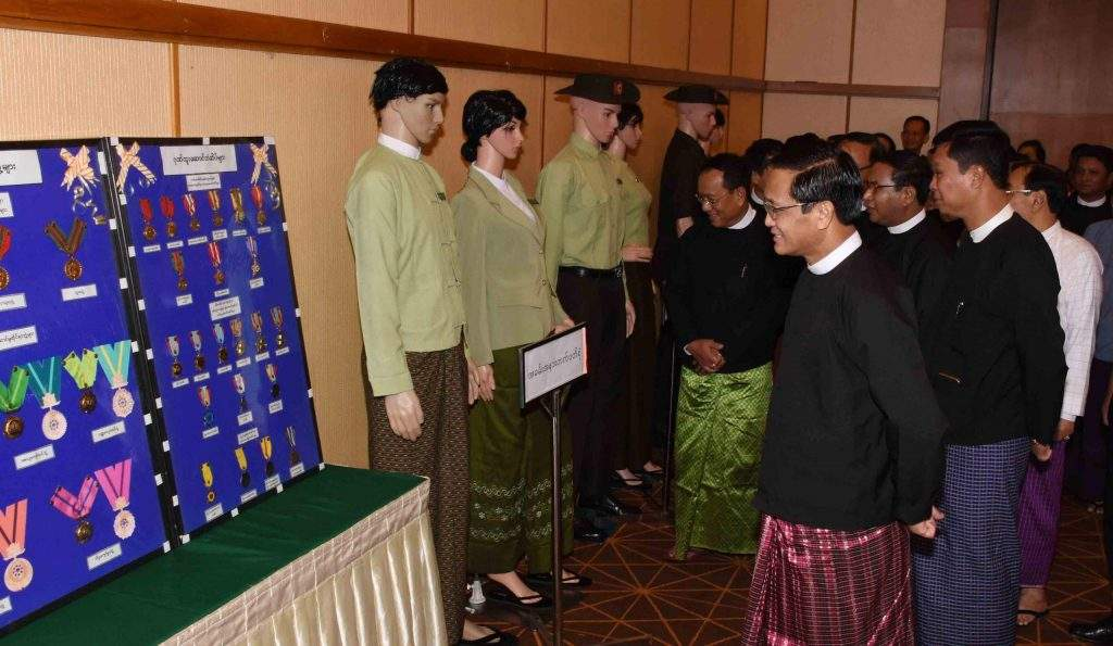 Vice President U Henry Van Thio visits the booth set up at anniversary of the General Administration Department. Photo: MNA