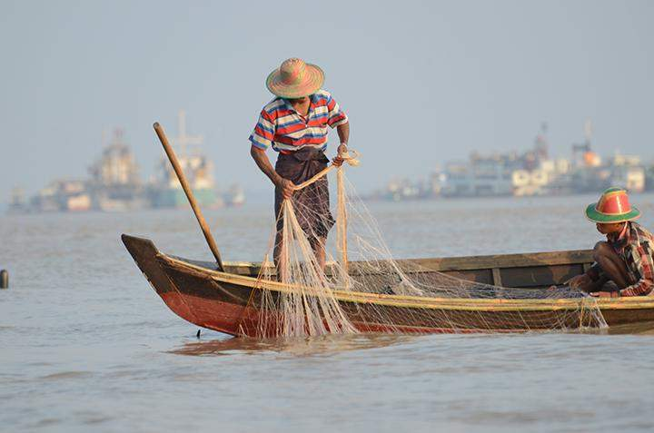 A man fishing with a net.