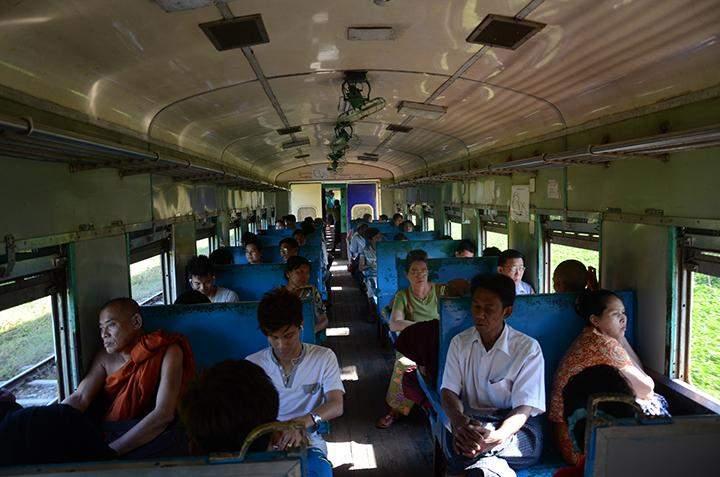 Passengers are taking a circular train in Yangon.