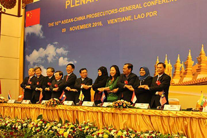 Prosecutors-General from ASEAN countries and China pose for a group photograph in ASEAN way at 10th ASEAN-China Prosecutors-General Conference. in Vientiane, Laos.