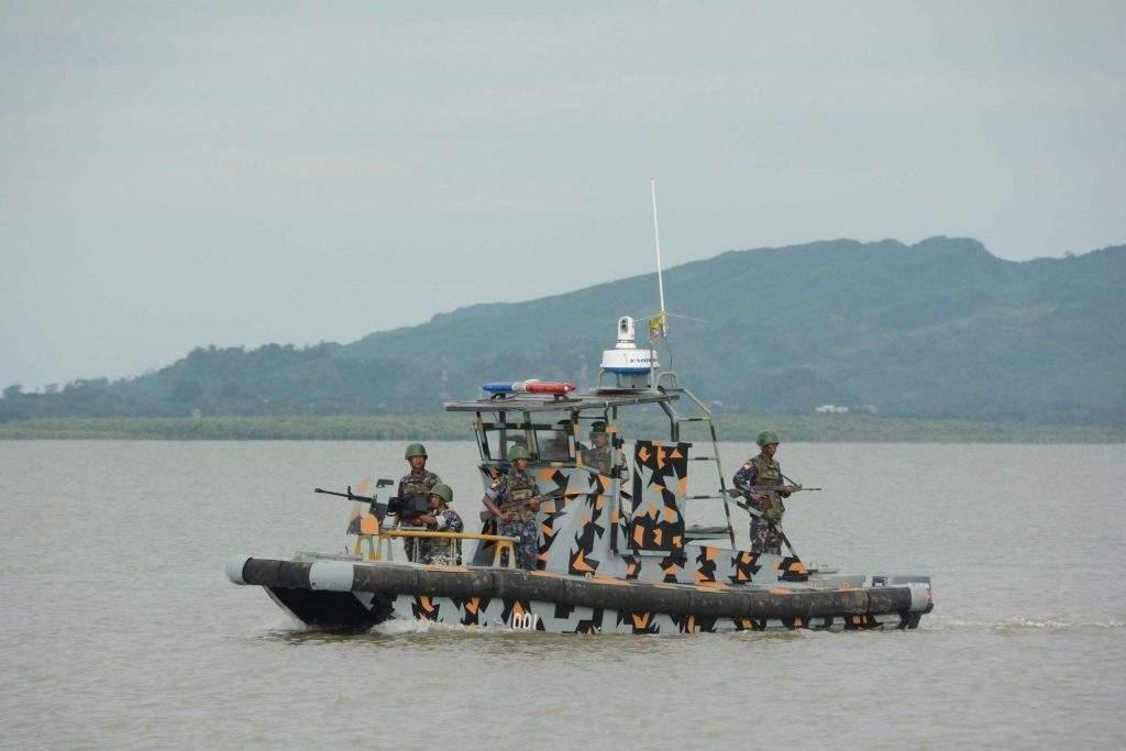 Myanmar border guard forces patrol along the Naf River. Photo: MNA