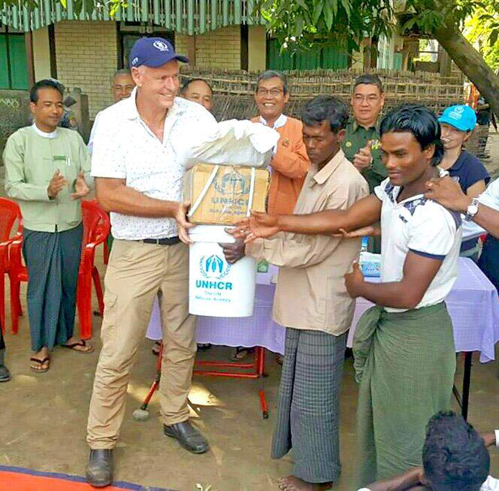 Mr Christopher Carter delivers aid to villagers from Muslim community in Maungtaw in northern Rakhine.