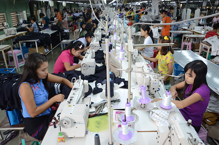 A file photo shows employees work on a production line at a garment factory in Hlainethaya Yangon Photo @ Phoe Khwar copy