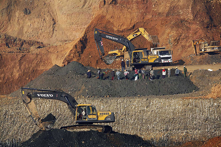 Myanmar copper mine mining investment natural resources A file photo shows people gather around machines at a jade mine in Pharkant Kachin state. Photo Reuters copy