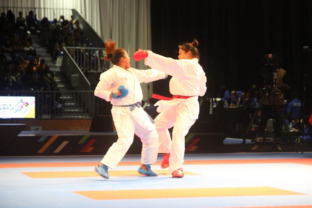 Myanmar Karatedo athlete May Thu Cho (right) fights against  the athlete fromTimor Leste at the 29th SEA GAMES. Photo: Public Sports and educative department