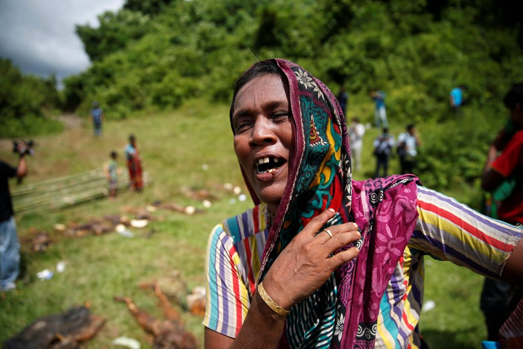 A Hindu villager reacts while identifying the bodies of relatives found by government forces that authorities suspect were killed by terrorists last month. The bodies were founf in mass graves near Maungtaw in northern Rakhine on Sunday. Photo: REUTERS/Soe Zeyar Tun