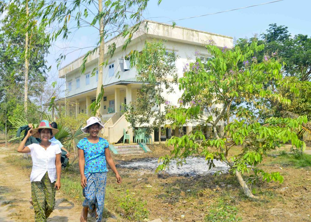 Women walk past the cyclone shelter in Kungyangon which was striken by Cyclone Nargis in 2008. The government yesterday instituted a programme that places higher priority on risk management and preparedness over natural disaster response.File Photo: Aye Min Soe