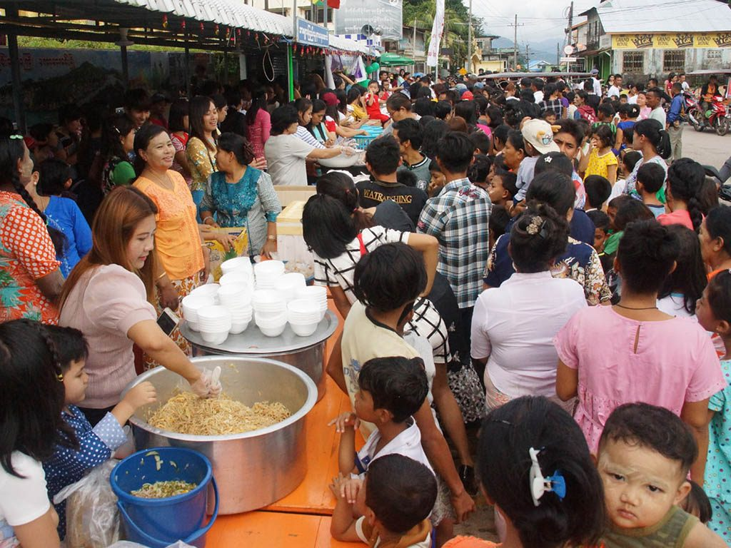 People gather to get charity food as they participate in the Nibbana Market in Kawthoung.Photo: Kyaw Soe