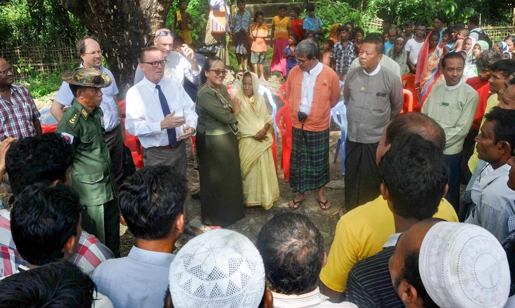 Rakhine State Chief Minister U Nyi Pu, centre, in saffron jacket, and UN Under Secretary-General for Political Affairs Jeffrey Feltman, centre left, meet with villagers.Photo: MNA
