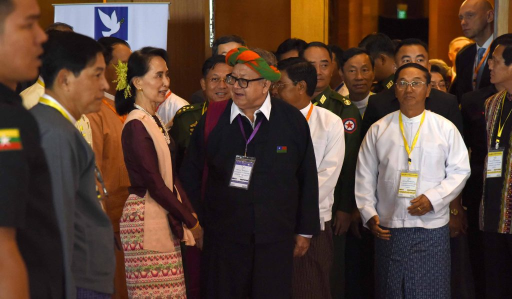State Counsellor Daw Aung San Suu Kyi converses with an ethnic representative. Photo: MNA