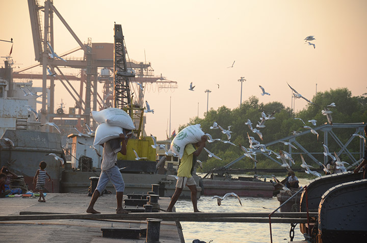 DSC 1918 Workers loading rice bags onto a ship at a Botahtaung jetty in Yangon. Photo Phoe Khwar