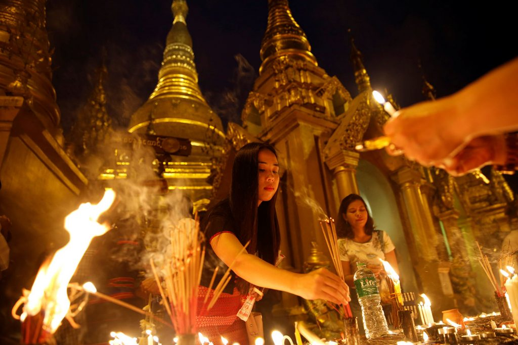 Women light incense and candles for prayers during the Thadingyut (Festival of Lights) full moon day festival at the Shwedagon pagoda in Yangon last night.Thadingyut marks the end of the three-month-long Buddhist Lenten period.Photo: REUTERS
