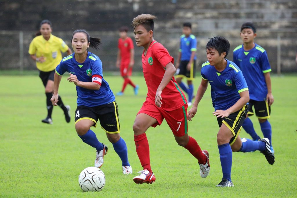 Players from Gandamar and Myawaddy vies for the ball in yesterday's match at Padonmar Stadium in Yangon. Photo: MWL