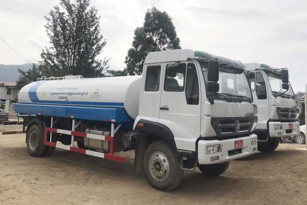 The two water bowsers donated by KBZ's Brighter Future Myanmar Foundation to Htantalan, Chin State.Photo: Thura Lwin (Eco)