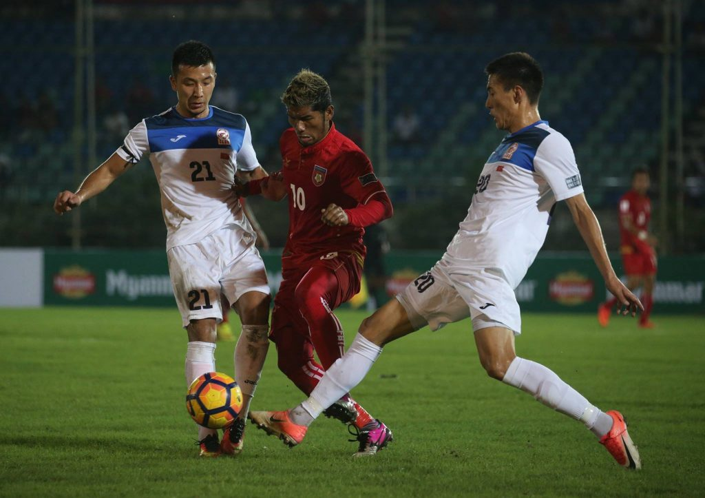 Myanmar (Red) and Kyrgyzstan (White) Vie for the ball at the previous qualifier on 10 October at Thuwunna Stadium in Yangon, Myanmar.Photo: MFF