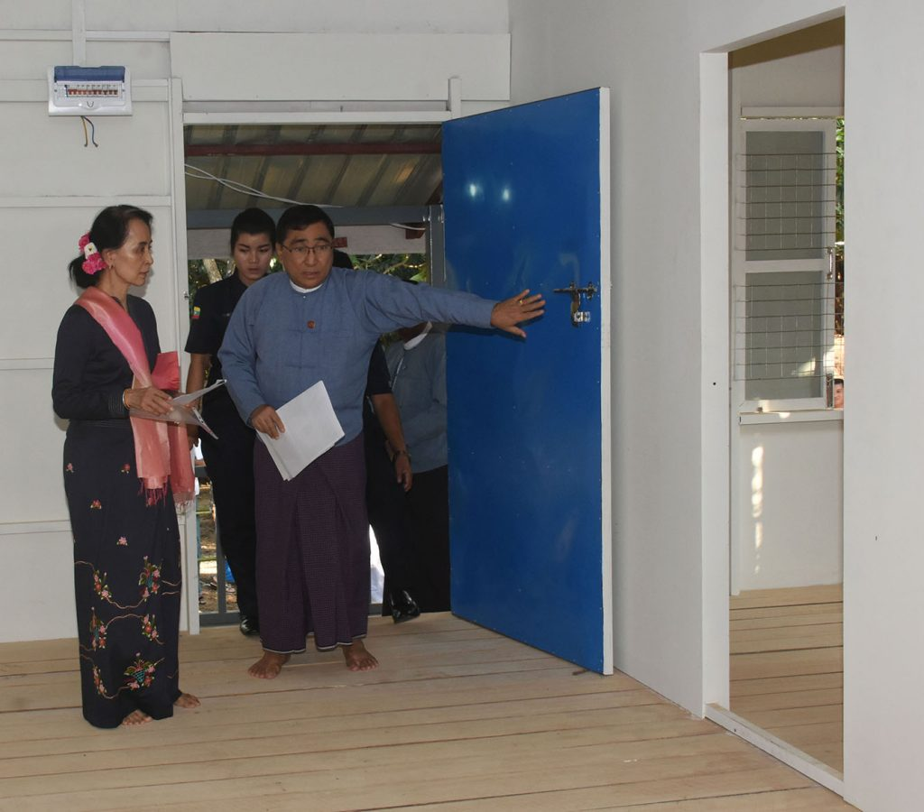 State Counsellor Daw Aung San Suu Kyi, left, inspects the model rural house which will be built and donated by the Daw Khin Kyi Foundation.Photo: MNA