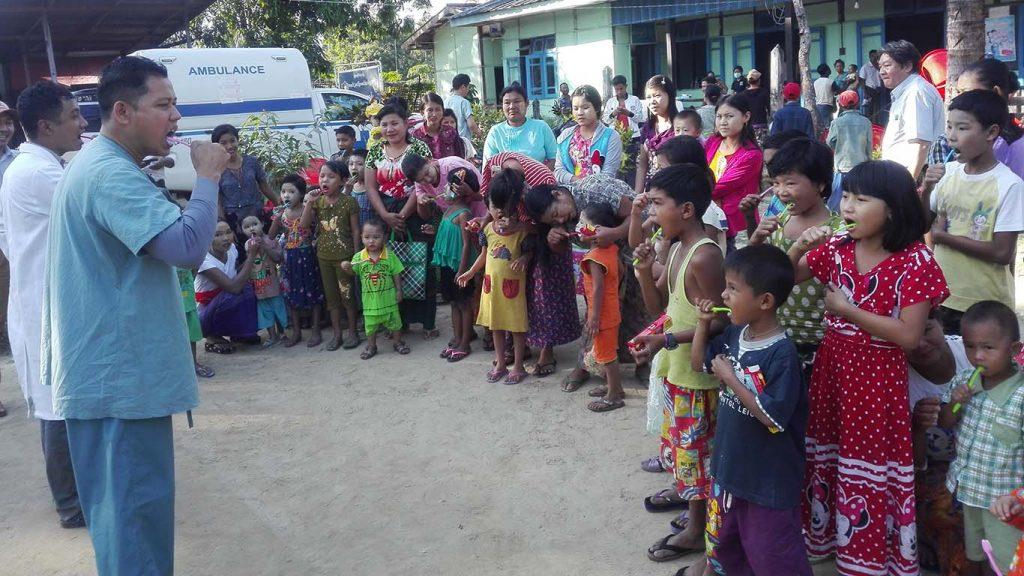 Volunteering Doctors greeting children in Rakhine State.Photo: Nay Win Tun