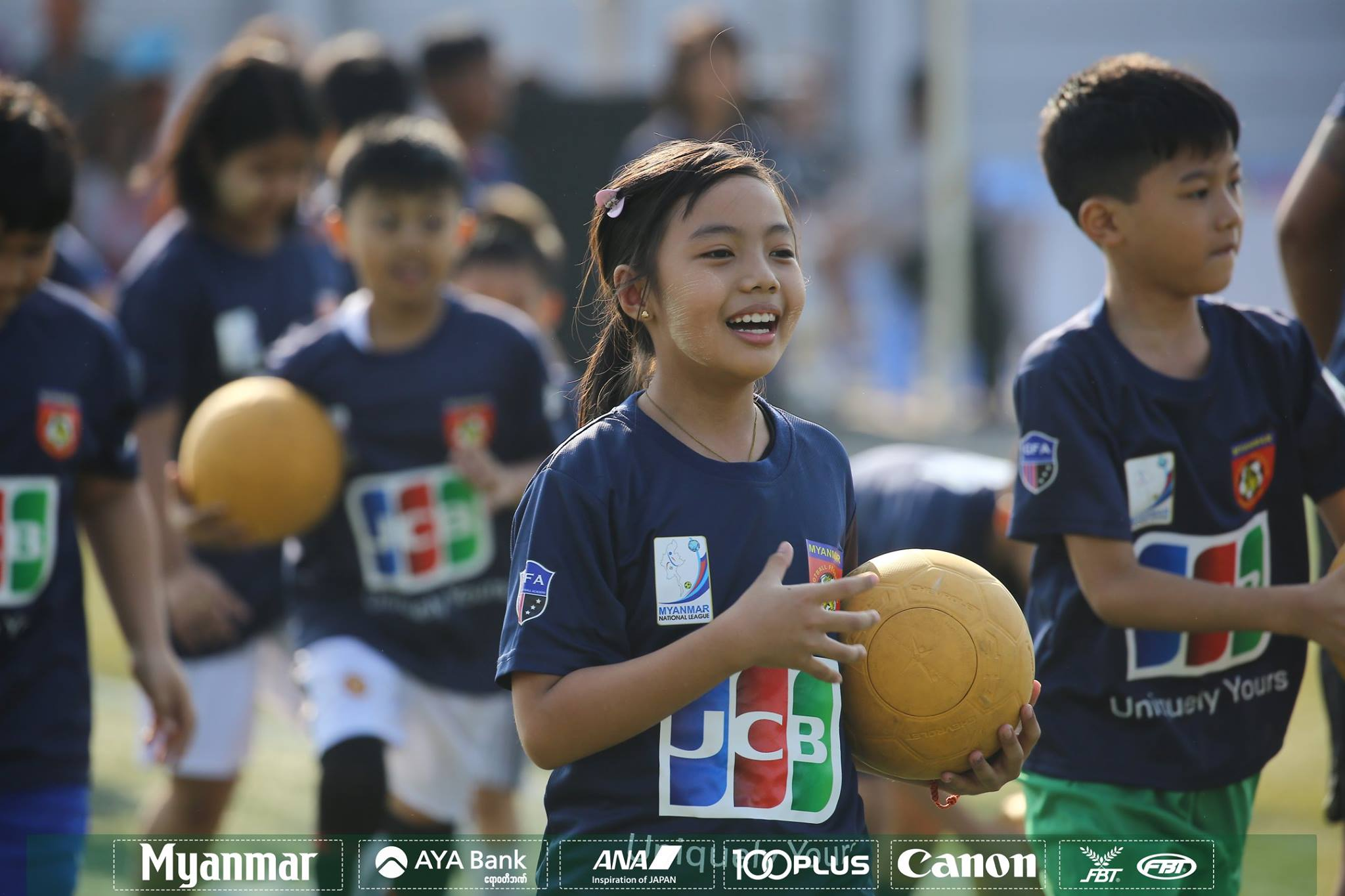 Kids seen at the JCB football clinic at the artificial turf ground of MFF in Yangon, Myanmar yesterday. Photo:MFF
