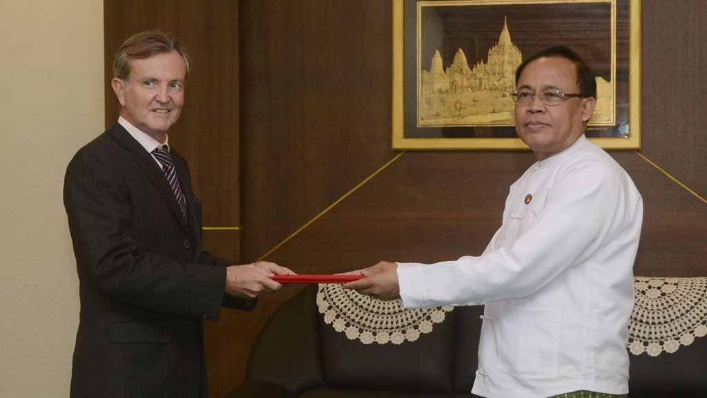 Union Minister U Kyaw Tin accepts the credentials from Mr. Andrew Kirkwood, Director & Representative of UNOPS.Photo:MNA