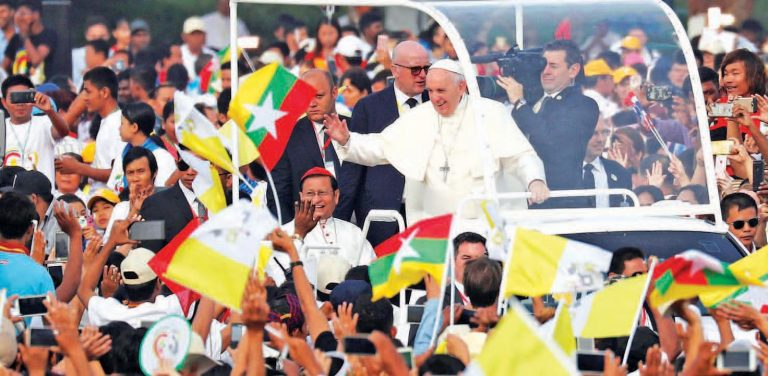 Pope Francis waves to Catholic Christians as he arrives to lead a mass at Kyite Ka San Stadium in Yangon on 29,November 2017. Photo REUTERS