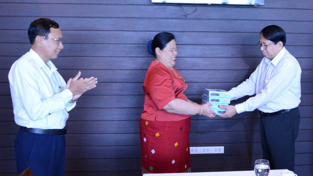 Union Minister for  Information Dr. Pe Myint hands over Set Top Boxes to Taninthayi Region Chief Minister Dr. Le Le Maw.Photo: MNA