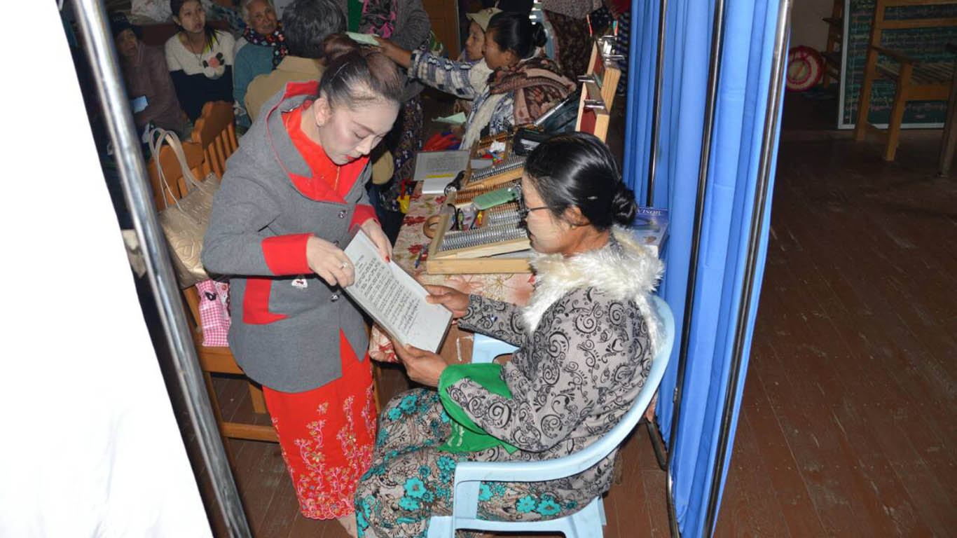 A woman examined by eye specialist at the monastery compound in Indaw Township.