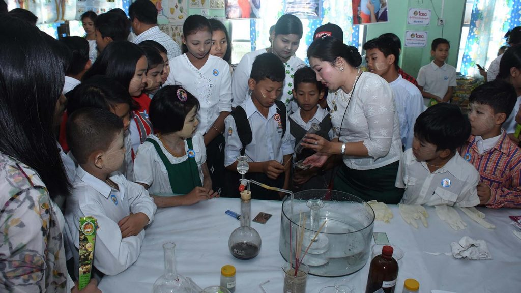 Students observe the experiment in science laboratory at Children's Literature Festival in Thanlyin. Photo: Zaw Min Latt