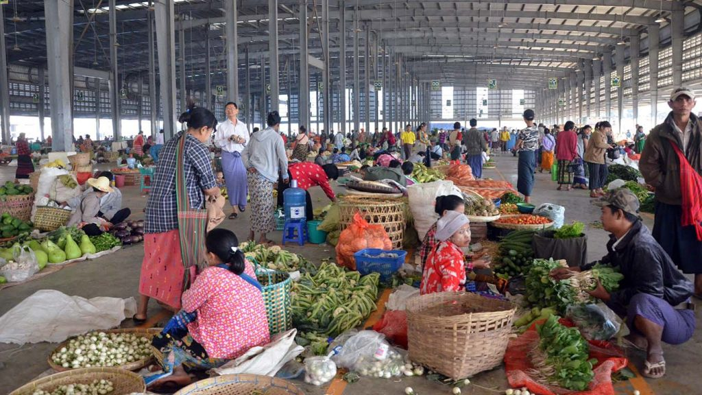 Vendors are seen at Danyingone wholesale fruit, vegetable and flower market in Yangon.Photo: Zaw Gyi