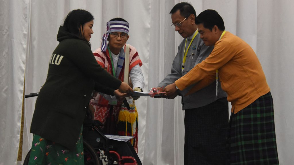 U Myat Thu Win and Saung Win hand over the policy papers to members of UCCPF. Photo: MNA