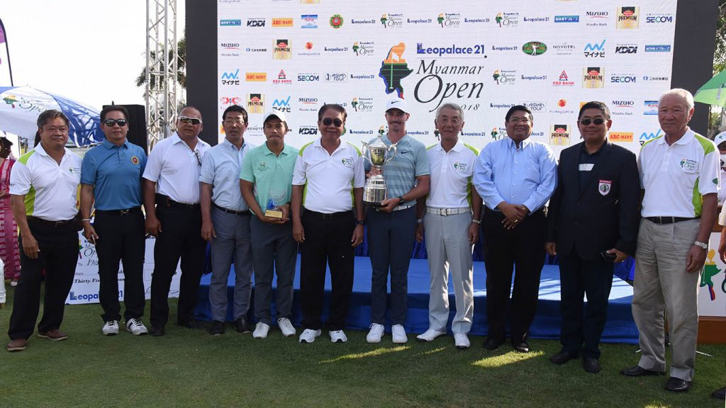 Champion of Leopalace 21 Myanmar Open Golf Tournament 2018 Paul Peterson holds the cup, seen with officials. Photo: Phoe Thaw Zin