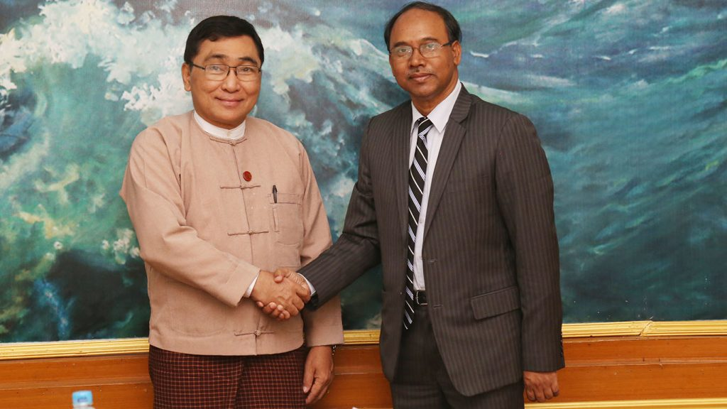 Union Minister Dr Win Myat Aye shakes hands with Bangladesh Ambassador Mohammad Sufiur Rahman. Photo: MNA