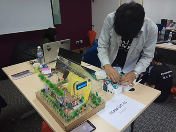 Technological University student designs his project at the Markerthon 2017 competition.Photo: Hla Moe