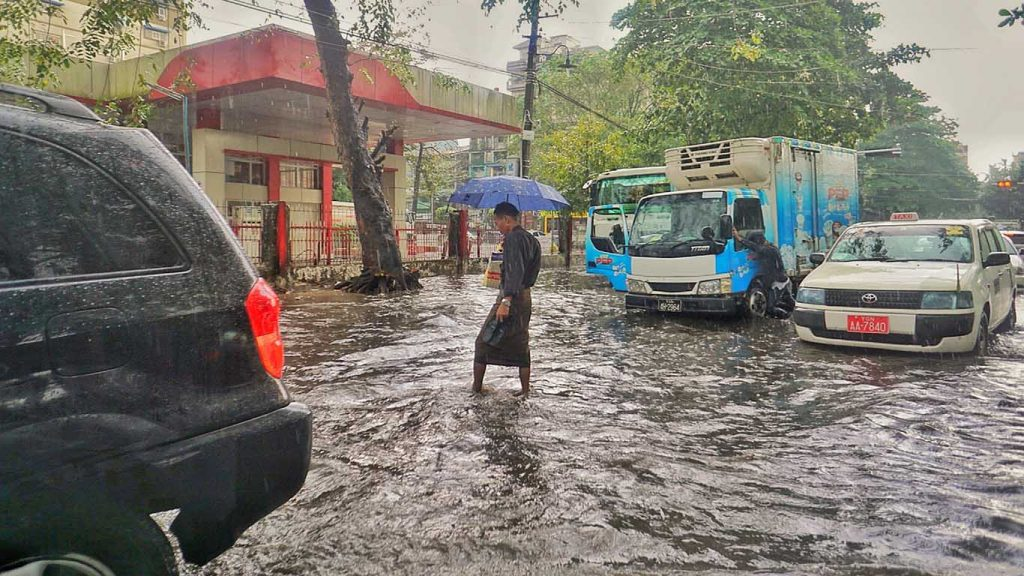 This scene on Baho Road near Bagayar Street in Sangyaung was one of the intersections that flooded yesterday afternoon. The high water slowed traffic to a crawl and caused one truck to stall. Scattered rain is expected over several parts of Myanmar today.  Photo: Mark Angeles
