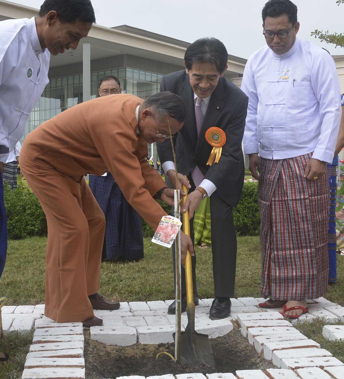 Union Minister U Ohn Maung and Mr.Ichiro Aisawa planting a cherry. Photo: MNA