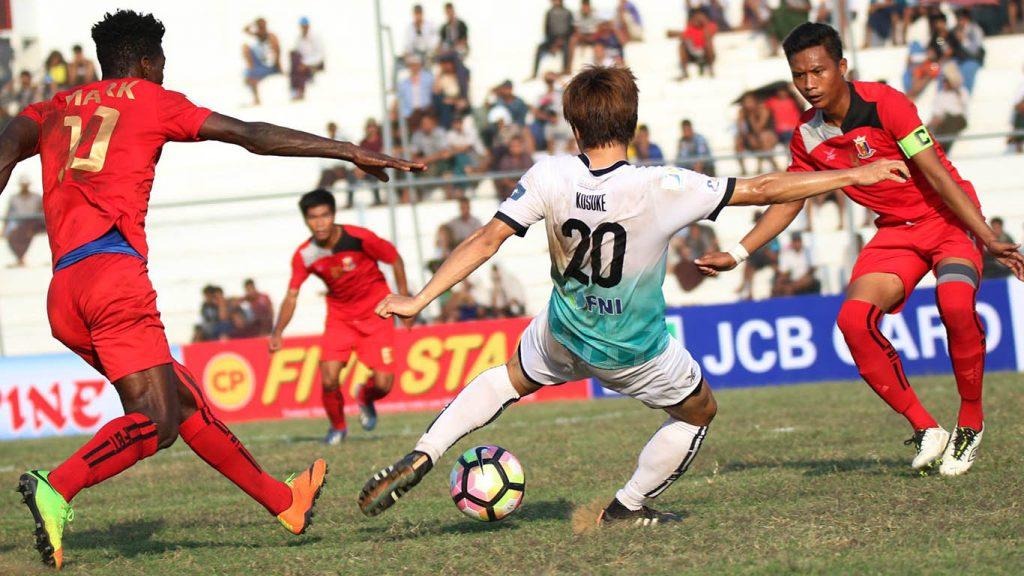 Yangon's reliable striker Kosuke Yamazaki poises to shoot the ball at yesterday's match in Grand Royal Stadium in Bago.Photo:MNLYangon's reliable striker Kosuke Yamazaki poises to shoot the ball at yesterday's match in Grand Royal Stadium in Bago.Photo:MNL