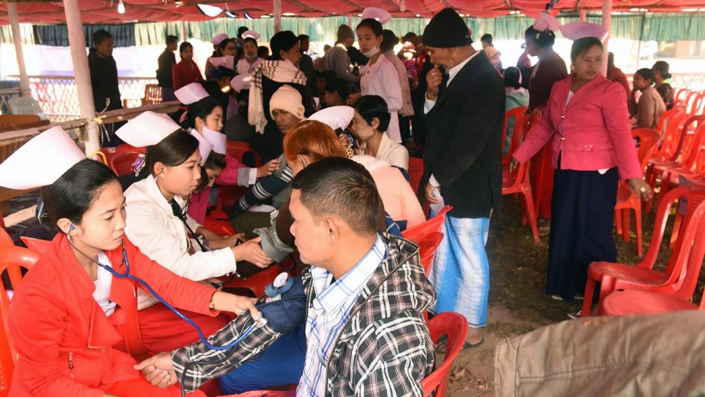 People receive medical check-ups provided by nurses in Buthidaung.   Photo: Aung Min