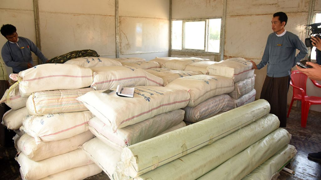 Authorities check the aid stored for returnees in Maungtaw as the government is ready to launch the repatriation.Photo: MNA